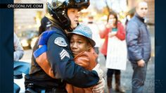 "Peace among protest: A Portland police officer noticed a 12-year-old boy holding a sign that read ""Free Hugs"" during a Ferguson demonstration in Oregon. The officer started talking to the boy about the demonstration, school and life. When they were done talking, the officer asked if he was going to get a hug. <3"