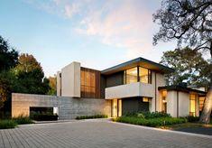 Beton Wand und helles Holz für Einrichtung und Fassade eines Hauses