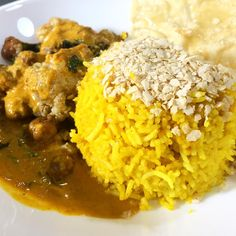 Briyani rice, with a rich and tasty chickpea cauliflower curry topped with papadum.