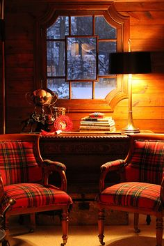 cozy red plaid chairs in a wood paneled room under a cool window~ideal.