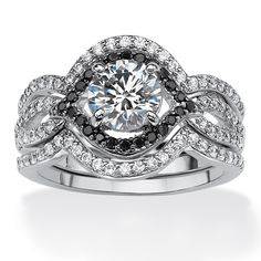 You won't be able to take your eye off this beauty. The center round cubic zirconia in this three piece bridal ring set.-Dzkg4cPa