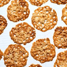 These cookies bake up really light and crisp, making a pleasant alternative to heavy and buttery holiday treats; dip them in melted chocolate and sprinkle with sea salt for a decadent lacy crunch. Best Holiday Cookies, Holiday Cookie Recipes, Best Cookie Recipes, Holiday Treats, Dog Food Recipes, Christmas Cookies, Bar Recipes, Holiday Baking, Christmas Treats