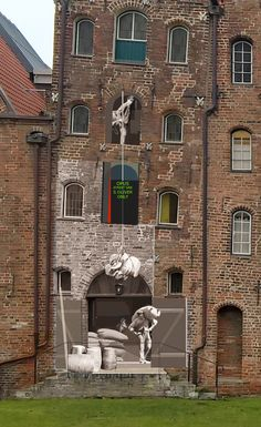 Installation of an old photo from 1930 on an building in german Lübeck
