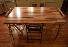 The advantage of butcher block is its resilience; after all, people use this stuff for cutting boards. Joining together multiple blocks can be time-consuming, though. The quickest route to a DIY dining table like this is to purchase a premade butcher-block countertop and to support the surface on hairpin legs.