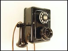 Model: WE 653  Made by: Western Electric Co. From: 1930s through 50s  Materials: metal body, bakelite receiver - Single piece phone built with the housing of a traditional WE metal subset (ringer box). Also called a 'hotel phone'. Uses a bulldog transmitter.