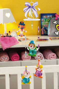 Do not want to do it yourself here is a hilarious mobility with clowns for a child's room? Modelling can be used cold porcelain or plastic
