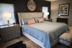 With a dark feature wall behind the bed (from Matter Brothers Furniture) the master bedroom in this renovated Sarasota home is serene and peaceful, but picks up the color scheme from the rest of the house.