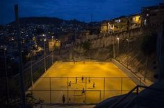 """In this Sunday, June 1, 2014 photo, youth play soccer in the Sao Carlos slum in Rio de Janeiro, Brazil. Whether professional-grade or improvised, in high-rent neighborhoods or tucked into """"favela"""" hillside slums, soccer fields are literally everywhere throughout this chaotic metropolis of 12 million. (AP Photo/Felipe Dana) ▼10Jun2014AP AP PHOTOS: Soccer fields are everywhere in Rio http://bigstory.ap.org/article/ap-photos-soccer-fields-are-everywhere-rio #Rio_de_Janeiro #Sao_Carlos_slum"""