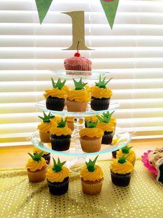First Birthday Hawaiian Luau Pineapple Cupcakes Hawaiian Cupcakes, Hawaiian Birthday Cakes, Luau Cupcakes, First Birthday Cupcakes, Second Birthday Ideas, Hawaiian Luau, Birthday Bash, Pineapple Cupcakes, Hawaiian Parties