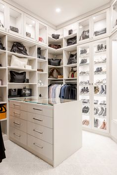 Light and bright walk-in closet with island. Shelves for storing designer bags and shoes. Everything has a place. Custom Walk In Closets, Walk In Closet Design, Bedroom Closet Design, Closet Designs, Closet Island, California Closets, Closet Office, Home Organization, Organizing