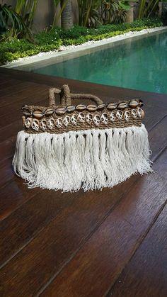 Small beach basket with shell and long tassel trim, raffia beach bag