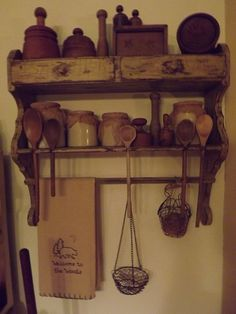 Primitive shelf I redid and painted Mustard and distressed...