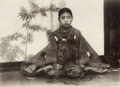 """The Attire of Boys of the Kamakura Period (1192 - 1342), Japan. A boy belonging to the upper class of the Kamakura period is represented in the following three pictures. His attire consists of a red outer-garment called """"Suikan,"""" a hakama, and an unlined yellow undergarment. Translated by K. Takigawa Text and image via Naomi no Kimono Asobi on Flickr. Photos appear to have been taken during the late 19th or early 20th century"""