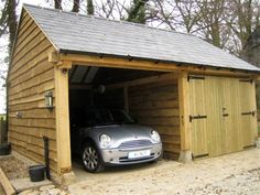 Oak garage and car port with slate roof.