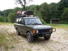 Range Rover Classic spare tire on top winch bumper. Nice!