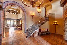 mediterranean decor ideas Saltillo tile floor staircase wrought iron banisters arches MUST READ THIS SITE