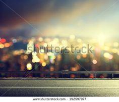 Asphalt road and blurred modern city - stock photo