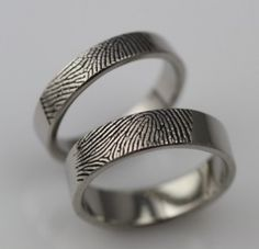 Custom made with the finger print of your spouse. Puts a whole new meaning into the wedding band. :)
