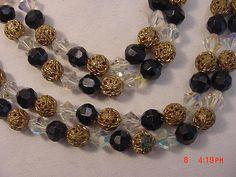 Vintage Aurora Borealis Crystal  Black Plastic & Gold Metal