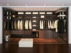 Closet and Wardrobe Designs. Modern stylish brown walk-in closet design with wooden wall-mounted shelves for nice saving-space ideas for clothes, shoes and accessories storage. Fancy Dream Home Interior Walk-in Closet Designs Walk In Closet Design, Wardrobe Design, Closet Designs, False Ceiling Design, Walking Closet, False Ceiling Living Room, Master Bedroom Closet, Bedroom Closets, Master Bedrooms