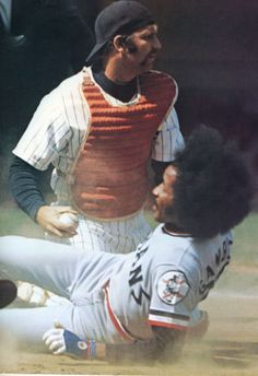 Thurman Munson, NY Yankees tags out Oscar Gamble, Cleveland Indians.  Looks like Gamble's Helmet airbag deployed.
