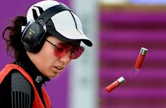 Turkey's Cigdem Oztaman empties her shotgun shells during the women's skeet event at the Summer Olympic Games in London, England, Sunday, July 29, 2012. (Wally Skalij/Los Angeles Times/MCT)