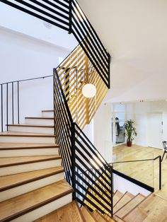 Refurbishment and extension of the City Hall of Pre Saint-Gervais by Zoomfactor Architectes ribbon balustrade 2 color inside outside wood tread painted white riser Stairs And Staircase, Wood Stairs, House Stairs, Grand Staircase, Staircase Design, Spiral Staircase, Architecture Details, Interior Architecture, Interior Design