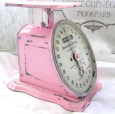 love love love this old pink kitchen scale  Have one but mine is sort of a pale yellow.