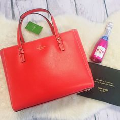 """2X HP 🎉 Kate Spade Grand Street Quinn New and never used Kate Spade Quinn bag! Gorgeous red color that will add a pop of color to any outfit. Comes with dust bag. Offers welcome. SIZE 9.4""""h x 11.5""""w x 4.5""""d MATERIAL boarskin embossed leather gold foil emboss w/ metal spade custom capital kate jacquard lining DETAILS shoulder bag with an open top interior zipper, double slide pockets, and center zipper pocket gold printed kate spade new york logo kate spade Bags Shoulder Bags"""