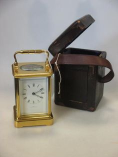 Sale D060815 Lot 56  Dent, London, a French gilt brass carriage clock with bell strike  - Cheffins