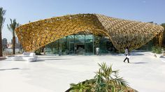 Butterfly Pavilion by at Noor Island, Sharjah, UAE. shades the Butterfly Pavilion with a golden canopy of 4000 aluminium leaves Rainforest Ecosystem, Butterfly Pavilion, Airport Design, Island Pictures, Glass Cube, Amazing Buildings, Roof Design, Retail Design, Architecture Details