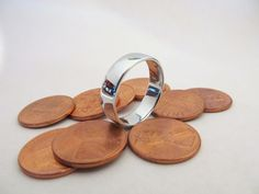 Smelt your own ring from pennies. Labor intensive but very cool.