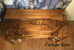 Decorative stain art with gradual shading.  Little vintage mahogany writing desk with inlaid epoxy.  Scene depicts the Bixby bridge in Big Sur, CA and a monarch butterfly.   Follow Custom Kate on Instagram #customkatepaints, Facebook, or https://youtu.be/PR8lV-K9uZk