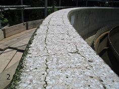 A lack of concrete waterproofing, heavy salt contamination and concrete spalling over the years resulted in general surface disintegration of the running track.  Cracking following the pattern of reinforcing steel illustrating inadequate concrete cover is present around the perimeter of the structure. http://www.cracksnorthwest.co.uk/concrete-crack-repair-using-specialist-polymer-modified-concrete-repair-mortar.html