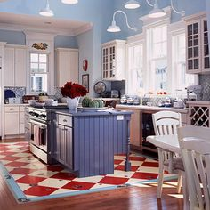 """Put Bold Color Underfoot. Paint an """"area rug"""" in the center of your kitchen. A large diamond pattern emphasizes the island as the center of attention."""