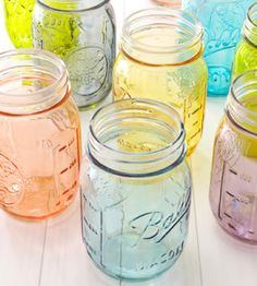 Tinted Mason Jars   1.In squeeze bottle, mix 4 tablespoons Liquitex Glazing medium with a few drops food color, gently swirl to blend 2.Hold Mason jar horizontally; pour the mix over the outer sides of jar, avoiding the screw threads. Rotate until jar is covered 3.Break any bubbles with a straight pin 4.Set jars upright on waxed paper to dry 5.Periodically wipe off excess glazing medium from the jar bottom with a paper towel.  Color is permanent, but jars are not dishwasher-safe