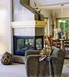 I don't prefer these in my own home, but three-sided fireplaces do a great job in certain settings as well.