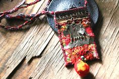 French Manufacture - Textile Pendant orange perfume realized from an old Hmong embroidery with bright and delicate colors . It is sewn on two layers of purple felt