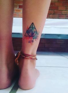 My watercolour deathly hallows tattoo.                              …