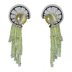 Earrings from the Sortilège collection in platinum, cat's eye chrysoberyls, chrysoberyl beads, black lacquer, brilliant-cut diamonds by Cartier