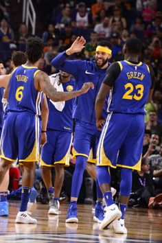 The Golden State Warriors celebrate a victory over the Phoenix Suns on April 8 2018 at Talking Stick Resort Arena in Phoenix Arizona NOTE TO USER...
