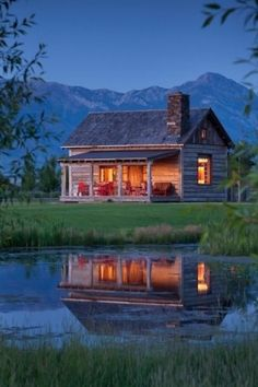 Oh man! Put me on at porch right now and ill be happy forever. Cabin by a Pond, Southern Country Living.