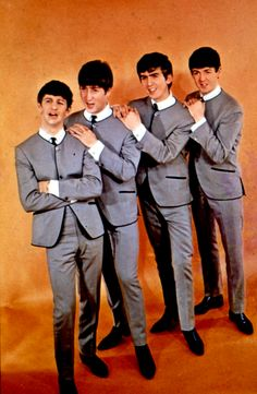The Beatles 1963 in collarless jackets