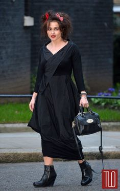 Helena-Bonham-Carter-International-Women-Day-Tom-Lorenzo-Site-TLO (1)  She's on her way to a reception at 10 Downing St.  With red n pink bows in her crazy hair.  I LOVE HER SO MUCH.