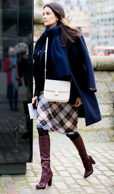 Pair a plaid pencil skirt with knee-high boots and a cross-body purse for a cool street style look