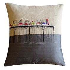 The Pier embroidered cushion by Lara Sparks    With Brighton pier serving as the initial inspiration for this cushion, this exclusively commissioned piece for us at Rume features highly detailed and colourful embroidery work depicting a selection of familiar fairground rides that you might find on a traditional English seaside pier.