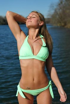 The perfect Damie Ann in a light-green swimsuit for Gary K.