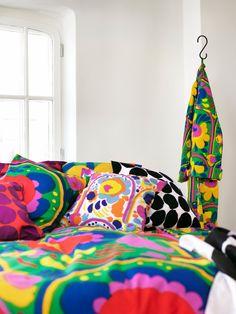 "MARIMEKKO Spring/summer 2016 home textiles. The duvet set on the bed and the bathrobe are of a classic Marimekko print called ""Karuselli"" (Carousel), designed in 1973 by Katsuji Wakisaka."
