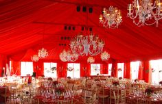 A tented red fabric event. Gorgeous!