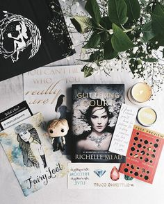 FAIRY LOOT UNBOXING ✨. Here are all of the wonderful things I received as part of April's @fairyloot box: . ≫ A full size Funko Pop - I got Peeta in mine which was so great as I already have Katniss so he looks perfect on my shelf next to her! . ≫ An exclusive Glittering Court poster from @behindthe_pages, which I love. . ≫ A gorgeous smelling vanilla bean candle, which of course I started burning straight away and now my rooms smells lovely! . ≫ Some amazing promo goodies - temporary gem…